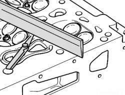 Проверка головки блока цилиндров на коробление